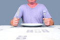 Eating alone gentleman waiting at a table waiting to eat Royalty Free Stock Photography