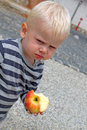 Eating apple young boy enjoying an Royalty Free Stock Photos