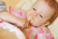 Eating baby girl dirty face Stock Images