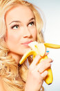 Eating banana portrait of a beautiful young woman fresh healthy nutrition diet Royalty Free Stock Photo