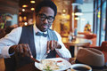 Eating in cafe elegant young man Royalty Free Stock Image