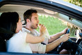 Eating in car couple men is driving and women is feeding him Royalty Free Stock Images