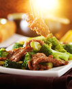 Eating chinese beef and broccoli stir fry Royalty Free Stock Photo