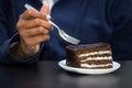 Eating chocolate cake Royalty Free Stock Photo