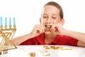 Eating Chocolate Gelt on Hanukkah Royalty Free Stock Photo