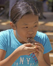 Eating contest event korean festival location kapi olani park waikiki o ahu hawai i usa subject a young girl competing in the Stock Image