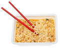 Eating of cooked instant ramen by red chopsticks from foam cap isolated on white background Stock Photo
