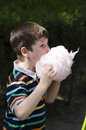 Eating cotton candy a young boy in herastrau park bucharest romania Stock Photo