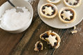 Eating delicious fresh baked christmas mince pies freshly decorated with pastry stars and sprinkled with icing sugar one half Stock Images
