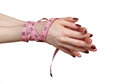 Eating disorder female hands tied with tape measure fighting Royalty Free Stock Photography