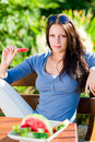 Eating fresh melon beautiful young woman bench Royalty Free Stock Photo
