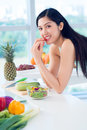 Eating fresh vertical portrait of a lovely young woman fruit and vegetables Stock Images