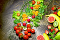 Eating healthy food - organic fruits and vegetables Royalty Free Stock Photo