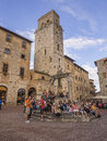 Eating ice cream in san gimignano from dandoli on the fountainin tuscany italy Stock Image