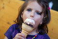 Eating an ice cream young girl enjoying Royalty Free Stock Photo
