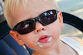 After eating an icecream young boy enjoying ice cream he wears sunglasses Royalty Free Stock Photography