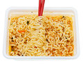 Eating of instant ramen from lunch box by red chopsticks isolated on white background Royalty Free Stock Image