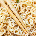 Eating instant ramen by wooden chopsticks of cooked close up Royalty Free Stock Photos