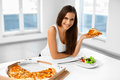 Eating Italian Food. Woman Eating Pizza. Fast Food Nutrition. Li Royalty Free Stock Photo