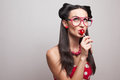 Eating lollipop pin up styling girl Stock Photo