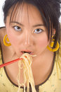 Eating noodles with chopsticks Stock Photo