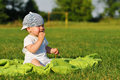 Eating outdor boy cookies little sitting on green lawn Stock Photo