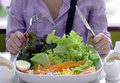 Eating salad healthy meal a girl with fork and knife about to eat delicious Stock Photos
