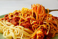 Eating spaghetti alla bolognese Royalty Free Stock Image