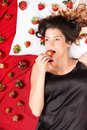 Eating a Strawberry Royalty Free Stock Photo