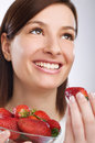 Eating strawberry Stock Photography