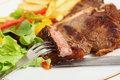 Eating T-bone steak Royalty Free Stock Images