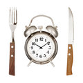 Eating time concept alarm clock knife and fork isolated on white backround Royalty Free Stock Photos