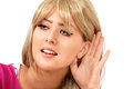 Eavesdropping or listening pretty girl cupping ear Stock Photos