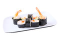 Ebi rolls on a dish eight roru with flying fish roe philadelphia cheese and shrimps tempura white rectangular isolated white Royalty Free Stock Photo