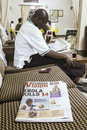 Ebola outbreak kasese uganda august man reading newspapers with bad news about in uganda on august kasese uganda Stock Images