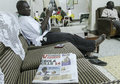 Ebola outbreak kasese uganda august man reading newspapers with bad news about in uganda on august kasese uganda Royalty Free Stock Image