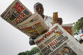 Ebola outbreak kasese uganda august young man hold newspapers with bad news about in uganda on august kasese uganda Royalty Free Stock Image