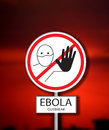 Ebola outbreak sign on crimson red background Royalty Free Stock Photo