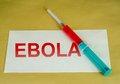 Ebola sign syringe and text on envelope Royalty Free Stock Image