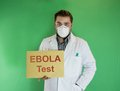 Ebola test young doctor with mask holding sign Stock Images