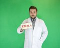 Ebola young doctor with mask holding sign Royalty Free Stock Image
