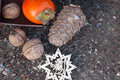 Ebony walnut fir cone and new year s wood star on the wire netting Stock Images