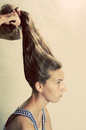 Eccentric hairstyle cute teenager girl with long hair gets an hairdress Stock Image
