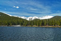Echo lake park and rocky mountains on sunny spring day under wind blown cirrus clouds Stock Photos