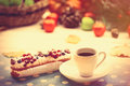 Eclair and cup of coffee on wooden table Stock Image
