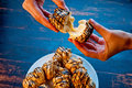 Eclair terminated with hands on a blue board background Royalty Free Stock Images