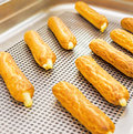 Eclairs on a baking sheet. Selective focus. Royalty Free Stock Photo