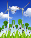 Eco energy bulbs with wind turbines green concept Stock Photo