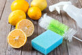 Eco-friendly natural cleaners baking soda, lemon and cloth on wooden table