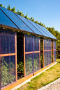 Eco glass house with solar panels Royalty Free Stock Photo
